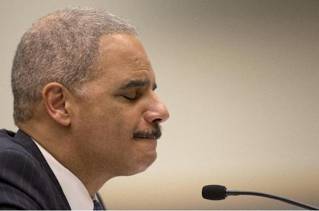 Attorney General Eric Holder pauses as he testifies on Capitol Hill in Washington, Wednesday, May 15, 2013, before the House Judiciary Committee oversight hearing on the Justice Department. Holder is