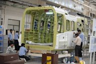 Indian technicians work at a helicopter cabin manufacturing facility in Hyderabad city on April 2. India's industrial output grew in February by a lower-than-expected 4.1 percent, data showed Thursday, fuelling expectations the central bank may cut interest rates for the first time since 2009