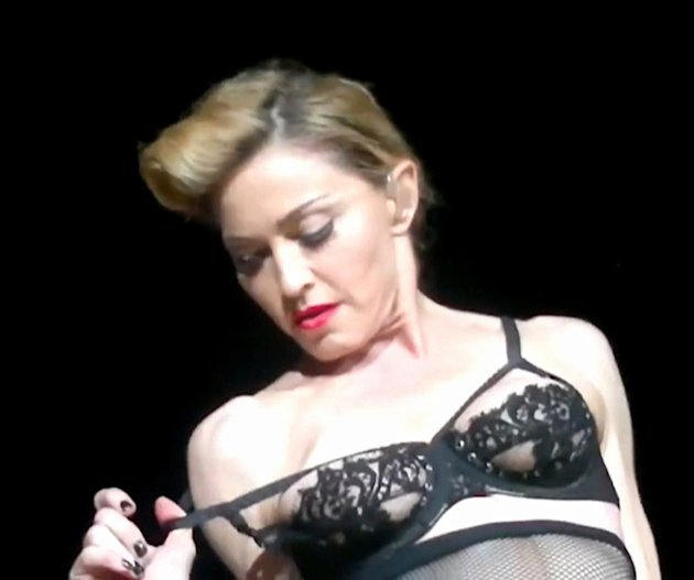 Madonna flashes her breast in a revealing black bra on stage in Istanbul