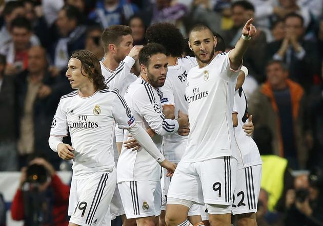 Real Madrid's Karim Benzema celebrates with team mates after scoring against Bayern Munich during their Champions League semi-final first leg soccer match at Santiago Bernabeu stadium in Madrid
