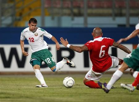 Malta's Dimech blocks a pass by Bulgaria's Nedelev during their 2014 World Cup qualifying soccer match at the National Stadium in Ta' Qali, outside Valletta