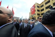 Turkish President Abdullah Gul arrives at the bomb scene on May 16, 2013 in Hatay just a few kilometres from the main border crossing into Syria