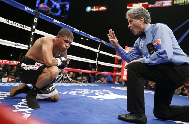 Referee Vic Drakulich counts after Juan Manuel Lopez was knocked down by Francisco Vargas during their WBO junior lightweight title fight, Saturday, July 12, 2014, in Las Vegas. (AP Photo/Eric Jamison)