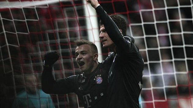 Bayern Munich's Mario Gomez (R) and Xherdan Shaqiri celebrate a goal against BATE Borisov