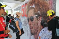 Thousands sing the poster to pay their respects to Marco Simoncelli