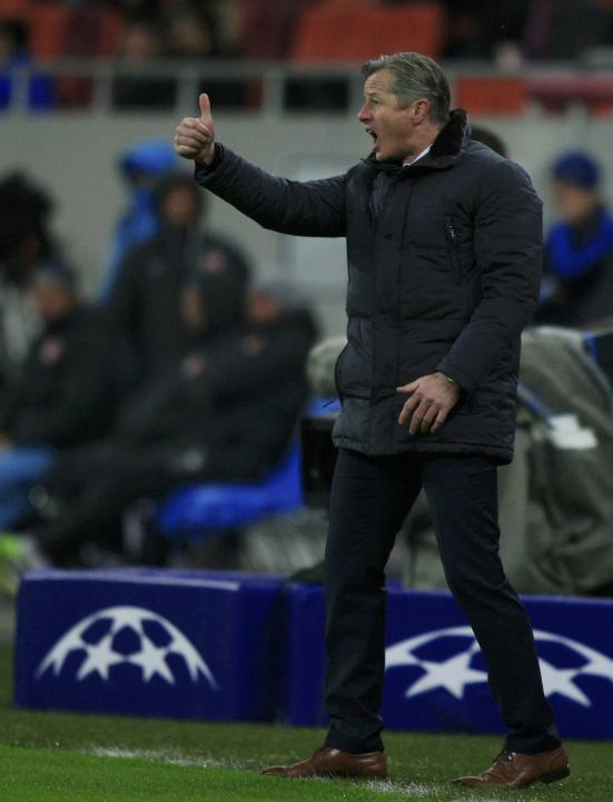 Schalke 04's coach Keller reacts during their Champions League soccer match against Steaua Bucharest in Bucharest