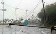 Utility poles lie on the road after being blown down during typhoon Tembin in Taitung, eastern Taiwan, on August 24, 2012. Typhoon Tembin swept across southern Taiwan, toppling trees and ripping off rooftops after thousands of people were evacuated to avoid a repeat of a deadly storm three years ago