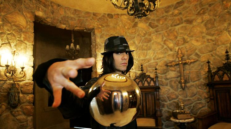"Criss Angel levitates a crystal ball during the filming of season six of ""Criss Angel Mindfreak."""