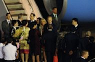 US Vice President Joe Biden (C-R) and his wife Jill Biden are greeted by officials upon arrival at the Paya Lebar military airport in Singapore, on July 25, 2013. Biden on Friday called on Asian nations to reduce tensions in disputed waters across the region as Washington redoubles efforts to confront China's growing maritime presence there