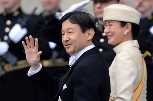 Japan's Crown Prince Nahurito (L) and his wife Crown Princess Masako leave the Nieuwe Kerk (New Church) in Amsterdam on April 30, 2013 after attending the investiture of King Willem-Alexander of the N