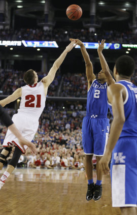 Aaron Harrison (2) makes the game-winning three-point basket over Josh Gasser in last year's Final Four. (AP)