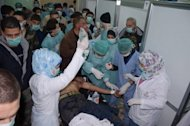 Image made available by the Syrian News Agency (SANA) on March 19, 2013, shows medics treating a casualty at a hospital in Khan al-Assal in Aleppo province. Syrian rebels have made use of the deadly nerve agent sarin in their war-torn country's conflict, UN human rights investigator Carla del Ponte has said