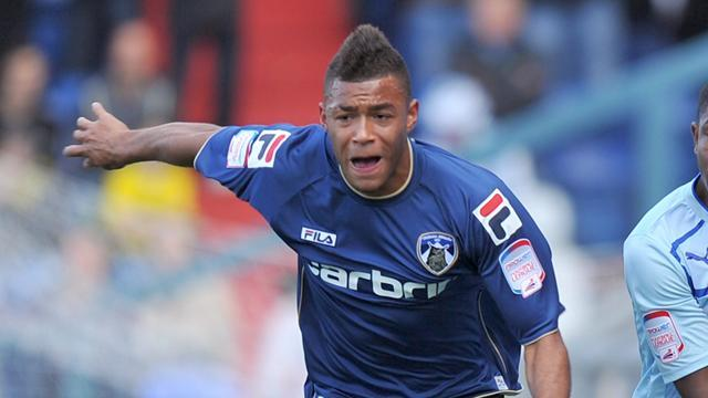 League One - Oldham extend Wabara deal