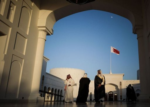 "Men walk along the corridor at the Sakhir Palace in Manama, on December 24, 2012, as delegates attend the annual Gulf Cooperation Council (GCC) summit. Iran on Wednesday rejected as ""baseless"" allegations by Gulf Arab states that Tehran is interfering in their internal affairs, the official IRNA news agency reported"