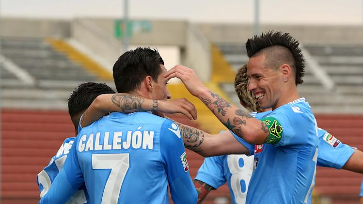 Napoli's Jos Callejon, of Spain, second from left, celebrates with teammate Marek Hamsik, right, after scoring during the Serie A soccer match between Udinese and Napoli at the Friuli Stadium in Udine, Italy, Saturday, Apr. 19 2014