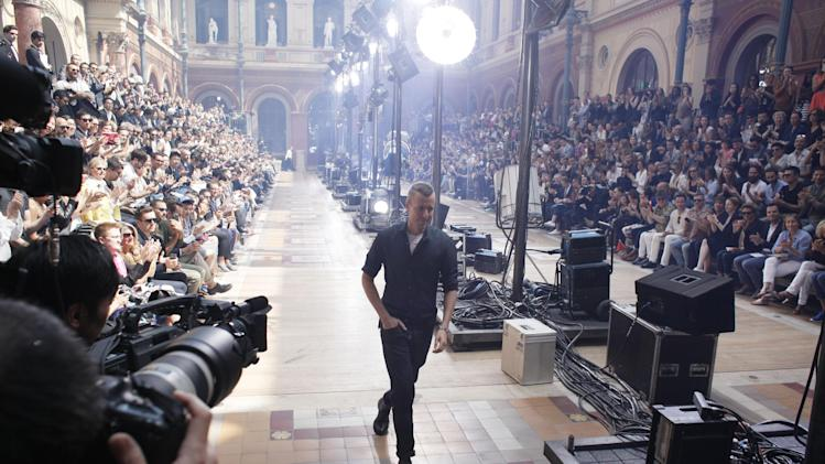 Dutch fashion designer Lucas Ossendrijver walks on the catwalk after the presentation of Lanvin's Spring-Summer 2014 men's collection, Sunday, June 30, 2013 in Paris. (AP Photo/Thibault Camus)