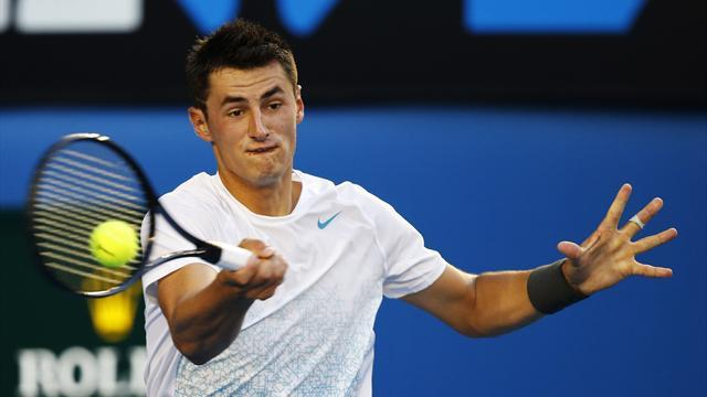 Tennis - Tomic father watches son play in Sydney despite ban