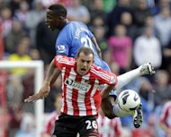 Sunderland's striker Steven Fletcher clashes with Wigan's defender Maynor Figueroa (up) during their English Premier League football match at The Stadium of Light in Sunderland, north-east England. Sunderland won 1-0