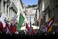 People protest against the Portuguese government's austerity policies at the Terreiro do Paco Square in Lisbon, on September 29. Thousands took to the streets of Lisbon in a new protest against government financial policies expected to get even tougher to meet pledges to creditors