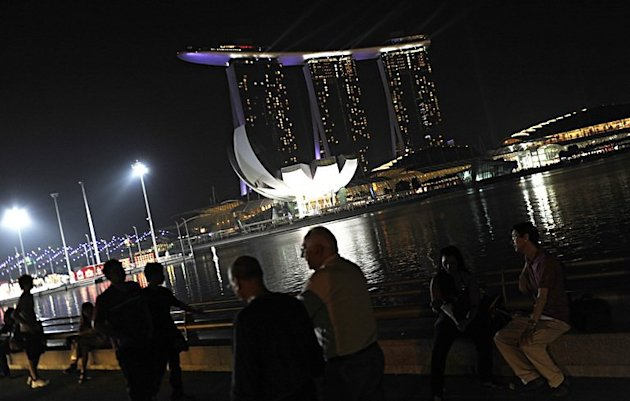 The lights of the Marina Bay Sands resort lighting up the waterfront in Singapore on February 9. Just one year after opening its first casino, Singapore has emerged as Asia's hottest new gambling capital with a revamped cityscape and billions of dollars pouring into the economy