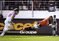 Toulon's flanker Steffon Elvis Armitage scores a try during a European Challenge Cup rugby union match in the French southern city of Toulon. Toulon won 32-29