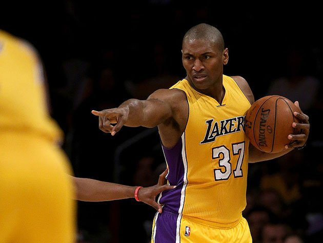 Metta World Peace runs the offense. (Getty Images)