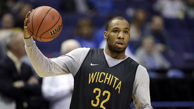 Wichita State's Tekele Cotton holds a ball during practice ...