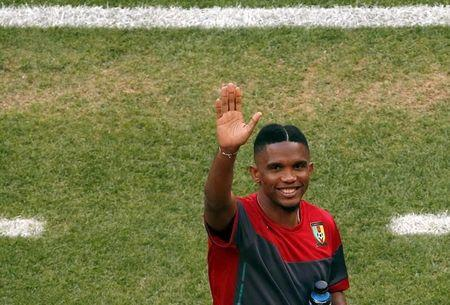 Cameroon's Eto'o waves to a supporter in the stands during a team soccer training session at the national stadium in Brasilia ahead of their 2014...