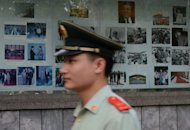 A Chinese paramilitary officer is pictured outside the North Korean Embassy in Beijing, on May 17. All 29 Chinese fishermen reportedly kidnapped by armed North Koreans earlier this month have returned home after they were freed at the weekend, according to the state Xinhua news agency