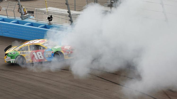 Kyle Busch spins out in Turn 1 during the NASCAR Sprint Cup Series auto race, Sunday, March 3, 2013, in Avondale, Ariz. (AP Photo/Matt York)