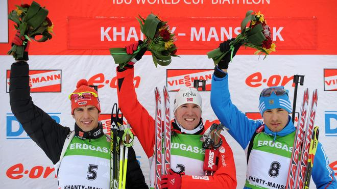 Germany's Arnd Peiffer (L), Norway's Emil Hegle Svendsen And Russia's Anton Shipulin (R) Celebrate Their Second, First AFP/Getty Images
