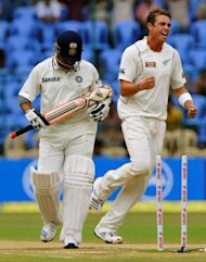 Indian batsman Sachin Tendulkar (L) walks back to the pavilion as New Zealand bowler Tim Southee (R) celebrates his dismissal during the fourth day of the second Test match between India and New Zealand in Bangalore on September 3, 2012