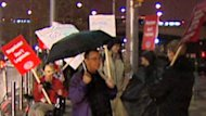Teachers began to gather in the rain in advance of a rally in front of the Ottawa Convention Centre.