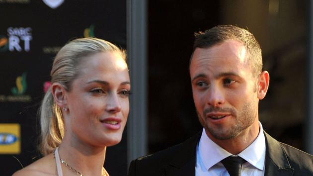 Reeva Steenkamp and Oscar Pistorius. Steenkamp was fatally shot at Pistorius's home near Pretoria, South Africa (Rex Features)