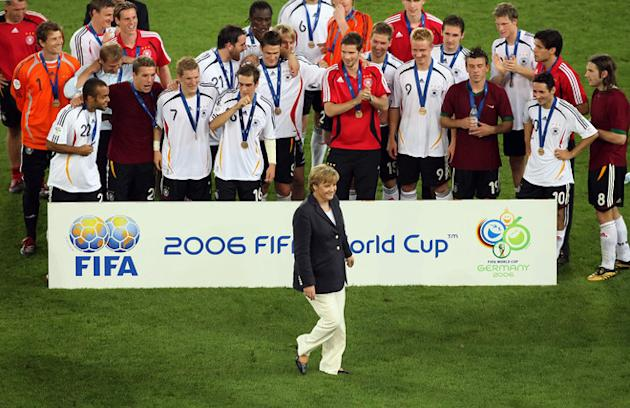 German Chancellor Angela Merkel (C) Walking In Front Of The German Team Following The Medal Presentation At The End Of  AFP/Getty Images