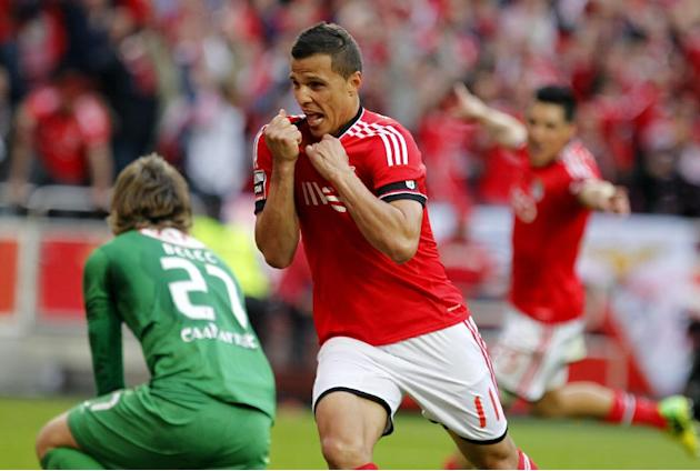 Benfica's Lima, from Brazil, celebrates after scoring the opening goal against Olhanense during a Portuguese League soccer match between Benfica and Olhanense at Benfica's Luz stadium in Lisbo