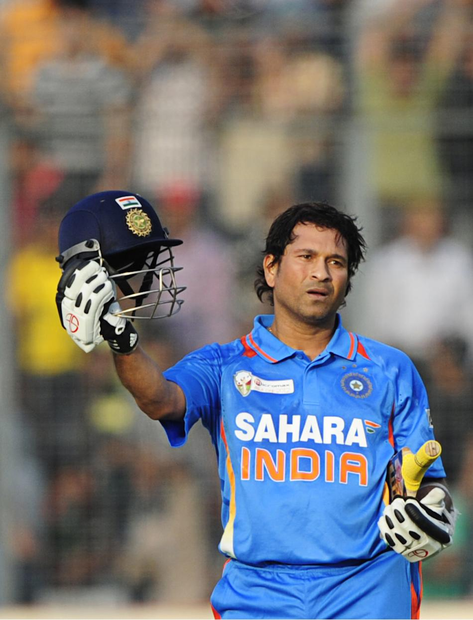 Indian batsman Sachin Tendulkar reacts after scoring his hundred century (100 runs) during the one day international (ODI) Asia Cup cricket match between India and Bangladesh at the Sher-e-Bangla Nati