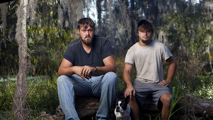 "Blake and Austyn in ""Swamp People."""