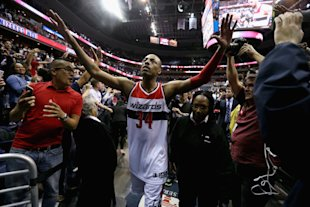 Paul Pierce high-fives fans while thinking of killer new Photoshops. (Rob Carr/Getty Images)