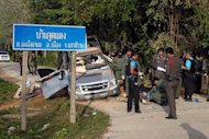 A Thai bomb squad inspects the site of a roadside bomb attack by suspected separatist militants in the southern province of Narathiwat, on January 30, 2013. Near-daily attacks -- including shootings, bombings and even beheadings -- mean violence is a part of life for many in Thailand's far south