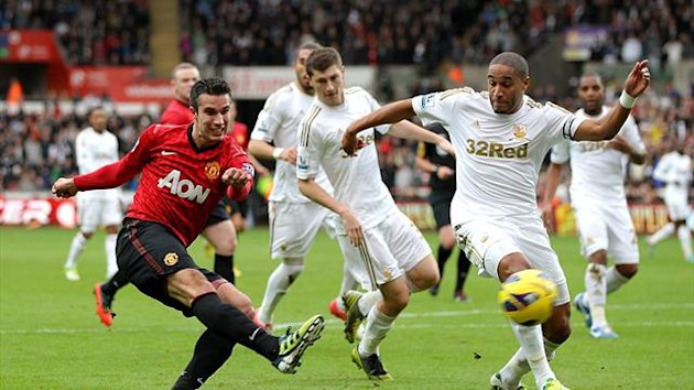 Roberto Martinez defended Ashley Williams, right, after he kicked the ball into the back of Robin van Persie's, left, head