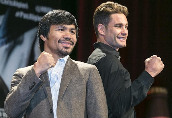 Boxers Manny Pacquiao, left, and Chris Algieri pose for a photo in Los Angeles, Wednesday, Sept. 3, 2014. They will fight for Pacquiao's WBO welterweight title at The Venetian Macao hotel on Nov. 22. (AP Photo/Damian Dovarganes)