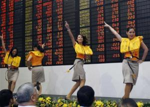 To match Insight PHILIPPINES/Cebu Pacific airlines cabin crew perform a safety demonstration routine during a ceremony inside a trading floor of the stock exchange in Makati's financial district of Manila in this October 26, 2010 file photo