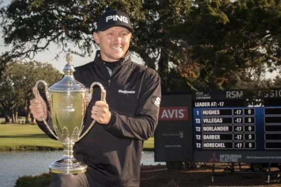 Mackenzie Hughes poses with the trophy after winning a playoff round at the RSM Classic golf tournament, Nov. 21 in St. Simons Island, Ga. (AP Photo/Stephen B. Morton)