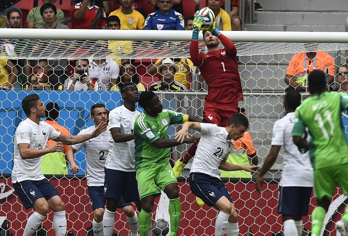 France's goalkeeper Lloris saves the ball during their 2014 World Cup round of 16 game against Nigeria at the Brasilia national stadium in...