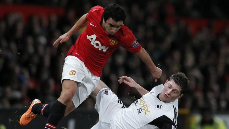 Swansea City's Davies challenges Manchester United's Rafael during their English Premier League soccer match in Manchester