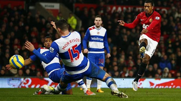 Manchester United winger Nani scores the opening goal against Reading