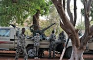 Malian soldiers stand guard on April 3 at the Kati military camp near Bamako. The soldiers who staged a putsch in Mali five weeks ago say they have defeated an overnight counter-coup by foreign-backed forces loyal to ousted president Amadou Toumani Toure