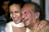This file photo shows legendary Indian sitar player Ravi Shankar (R) sharing a joke with his daughter Anoushka (L) during a press conference in Calcutta, on December 18, 2002. Shankar performed his last concert on November 4, 2012 in Long Beach, California, with his daughter and fellow sitar player Anoushka