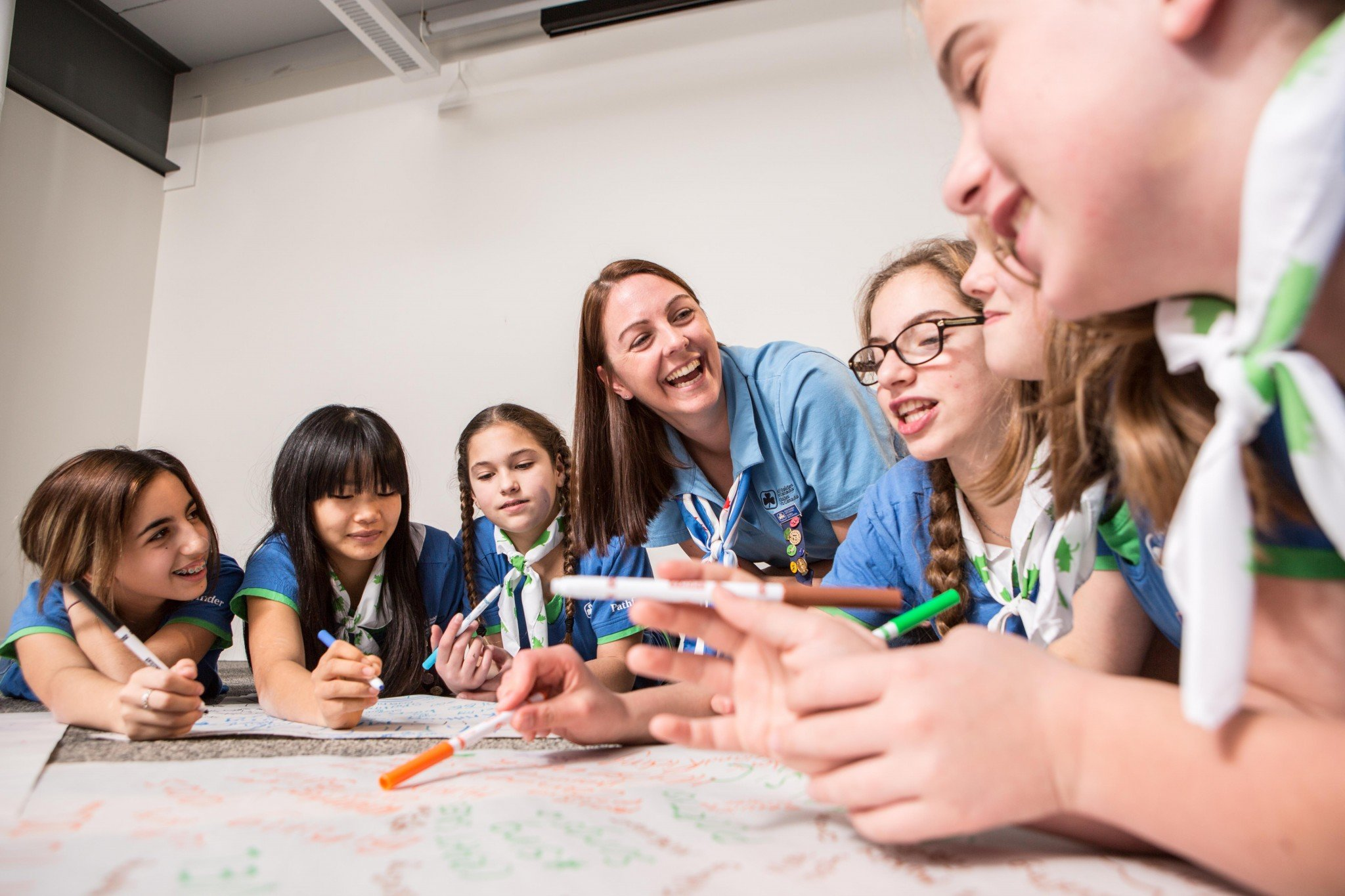 A volunteer works with a group of Pathfinders (girls aged 12-14). (Photo: Girl Guides of Canada)